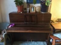 Piano free to loving home
