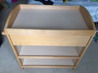 Changing table with drawer, shelves and rail