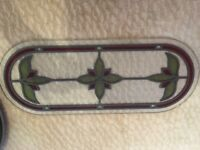 Stained glass panel in very good condition. 65cm x 26cm. Red and Green detail