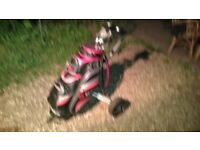 Motocaddy golf bag, set of clubs, and a lightweight trolley