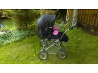 NEARLY NEW DOUBLE PRAM WITH RAIN COVERS