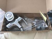 Brand new basin mixer taps still in box with waste