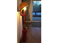 A one off industrial sculpture floor lamp with a firefighting theme. Open to reasonable offers