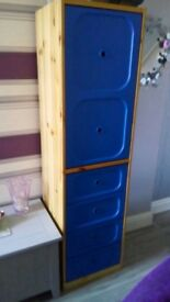IKEA tall cupboard storage.