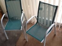 2 small children's seats. In or outdoors.