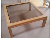 Large solid oak coffee table with glass insert.