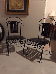 Wrought iron chairs. Pair
