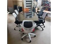 New ex warehouse black gloss boardroom table with 6 odd used chairs