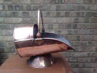 Old fashioned copper coal scuttle