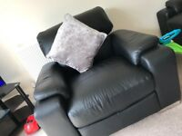 black real leather single seater sofa by Alan ward
