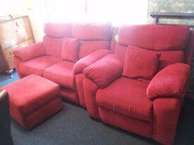 red sofa, chair and storage footstool