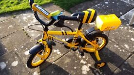An Apollo child's tricycle in very good condition, hardly used with steady wheels.