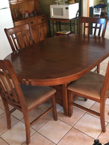 Beautiful wooden table with 4 chairs.$550.00