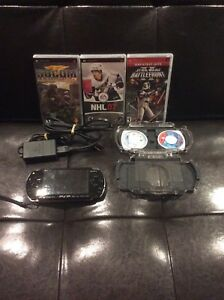 PSP 1001 in excellent condition + hardcase, 4 games and 1 movie