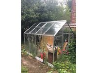 Free greenhouse for collection. No door and some glass missing but very usable. Self opening window.