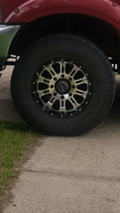8 bolt Ford Aftermarket Moto Metal Rims and 33.5 tires