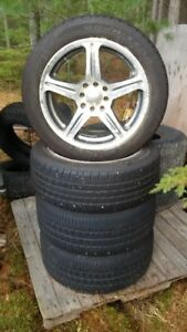 TWO NEW AND TWO USED TIRES ON RIMS!