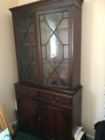 Reproduction mahogany display case/cupboard. Will come apart for transporting.
