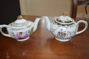 Two Adeline teapots with gold trim