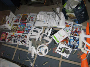 Wii game set with 15 games plus wii fit..tons accessories