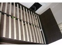 Double bed frame with brown faux-leather head-board