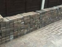 250 (approx) red / grey block paving blocks