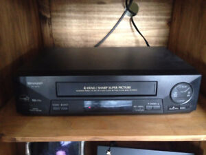 VCR / VHS player and 80 movies