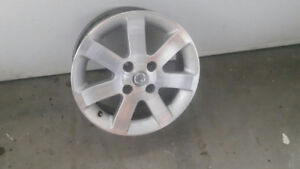 4 Nissan Mags Barely Used