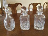 Three cut glass crystal decanters