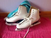 White ice skates, size 42