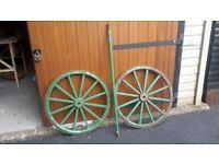 very heavy iron cart wheels with axle.