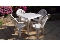 4 WHITE PLASTIC CHAIRS AND MATCHING TABLE