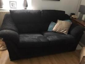 2 x black SCS sofas