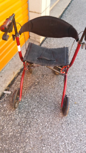 Gently used walker by airgo.