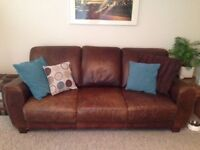 Brown leather 3 and 2 seater sofa for sale.
