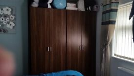 2 double wardrobes a set of draws and 2 bedsite cabinets