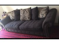 DFS 4 seater charcoal sofa with storage foot stall. Moving abroad so need to sell.