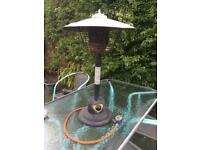 Table top patio heater and regulator