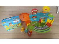 Toot toot drivers garage with 3 vehicles and deluxe track set