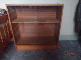 wooden book cabinet with glass sliding door
