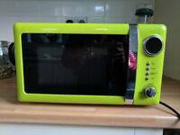 Used bright green Microwave