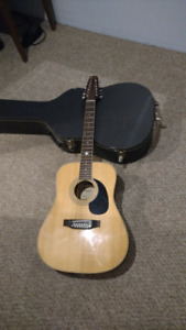 12 string citation acoustic electric guitar for trade.