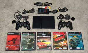 PS2 Slim, 2 Controllers & 5 Games