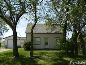 Fenced super sized lot with 2 BR older home in Shoal Lake MB!