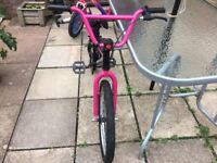 pink and black BMX