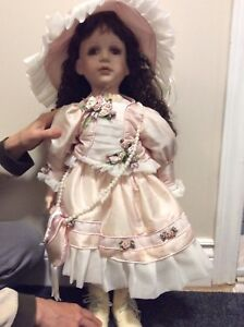 Doll. Porcelain head and hands.