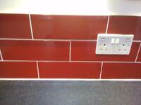 5 square metres of pillar box red tiles