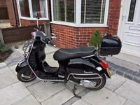 Vespa GTS 125cc. Low mileage, cheap to run and tax.