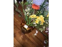 Large vintage brown vase with faux flower arrangement