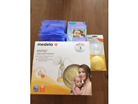 Medela Swing Electric Breast Pump with extras